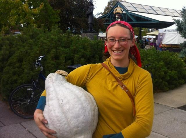 Selecting local squash to fuel my spleen-pancreas at our downtown farmers market