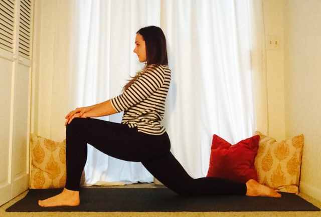 Instructor Courtney Morgan of Revolver Yoga Studio demonstrates a simple lunge yoga pose from her yin yoga class