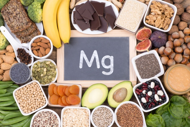 Magnesium food sources, top view on wooden background